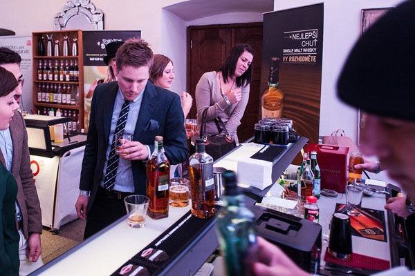 Customers tasting Johnny Walker Black Label whiskey at the Prague Bar Show