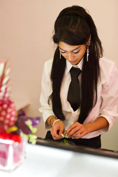 A bartender cuts fresh mint for a mojito in a catering event