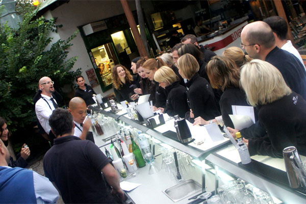 A long line of Justincase bars full of customers waiting for their cocktails