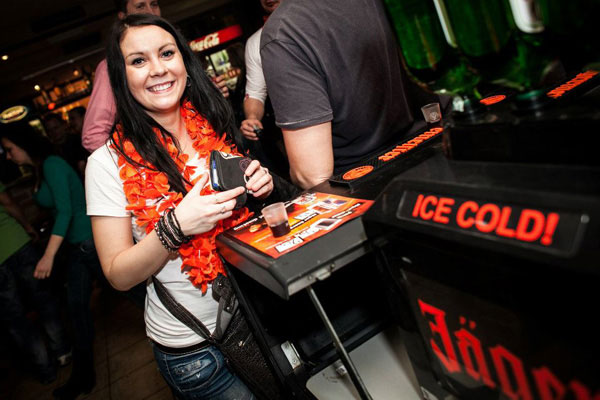 Woman drinking Jaegermeister shot in a club event