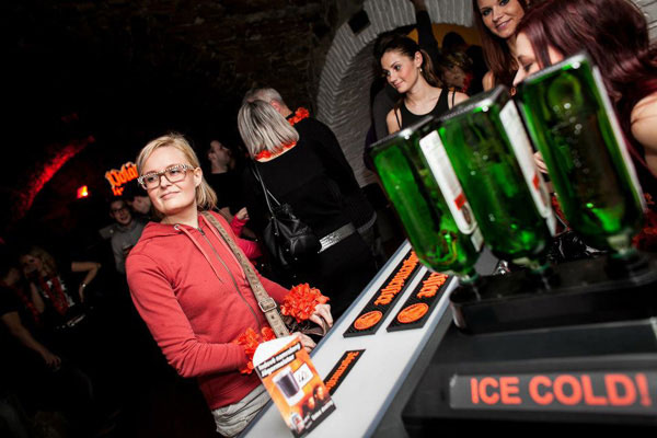 A woman waits for her drink at the Jaegermeister bar