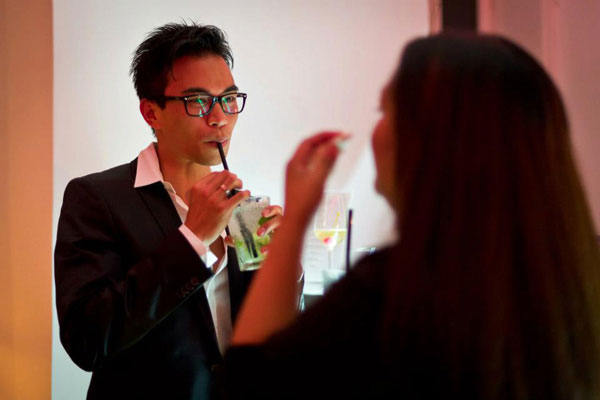 A young man zips on a fresh cocktail